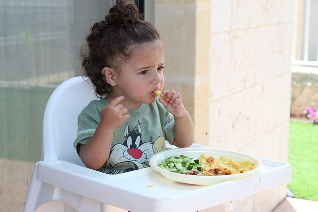 child eating dinner