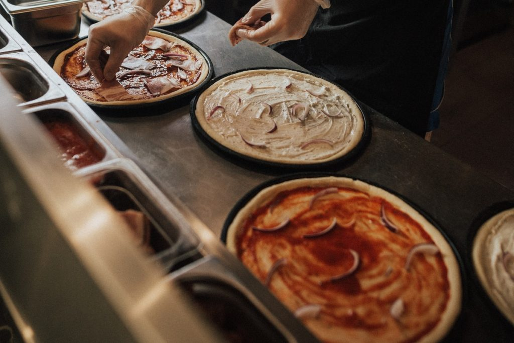 A food handler safely prepares pizza. What can an environmental health officer do if she doesn't?