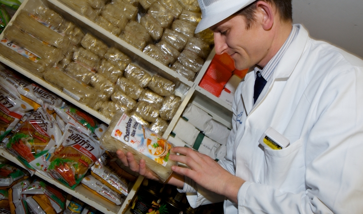 A food hygiene inspector reviews goods on an EHO Visit.